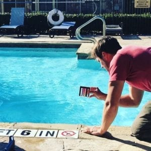 A Technician Tests the PH Balance of the water in a swimming pool