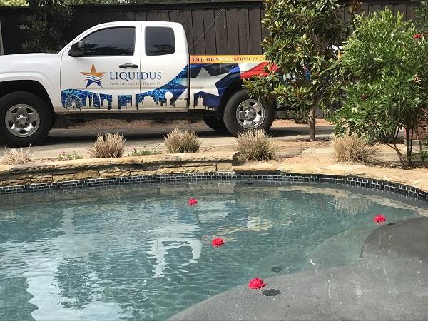A Liquidus Pools service truck pulls up near a client