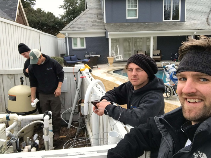 The Liquidus team works on a broken pump