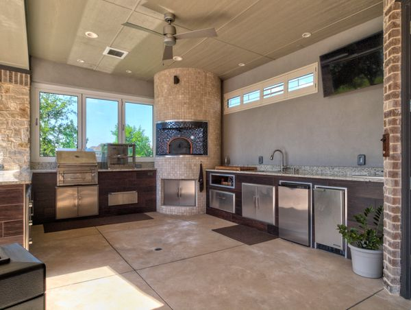 Beautiful custom outdoor kitchen under a covered patio