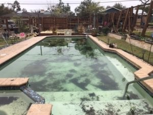 A pool that has been damaged after a natural disaster.