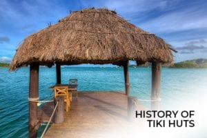 A Tiki Hut surrounded by beautiful crystal clear water, with the words, history of tiki huts.