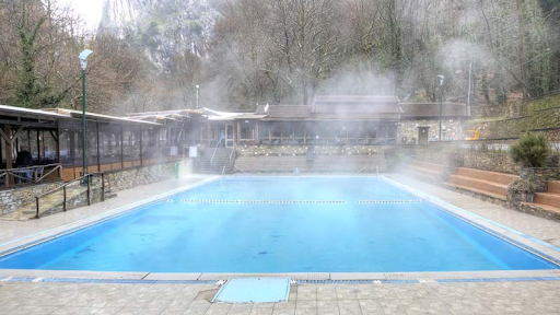 A beautiful shot of steam coming off of a heated pool.