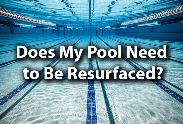 "A gorgeous clear pool with the words, ""Does My Pool Need to Be Resurfaced?"""